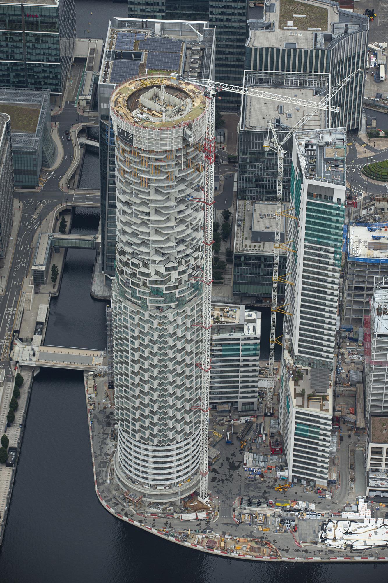 Herzog & de Meuron tops out cylindrical Canary Wharf flats