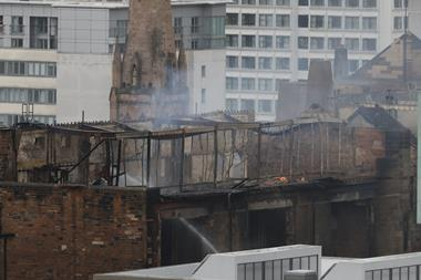 The extent of the damage is clear as firefighters tackle the last pockets of the second fire at the Mackintosh Building in Glasgow, June 2018