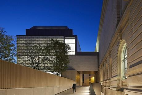 The bridge between the main extension and the existing gallery spans a new pedestrian route