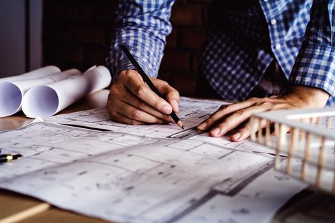 Architect-drawing-shutterstock_740754769