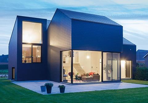 Fibre cement slate cladding can provide a smooth, continuous building envelope, as on this house in Belgium where Marley Eternit's Vertigo range was specified