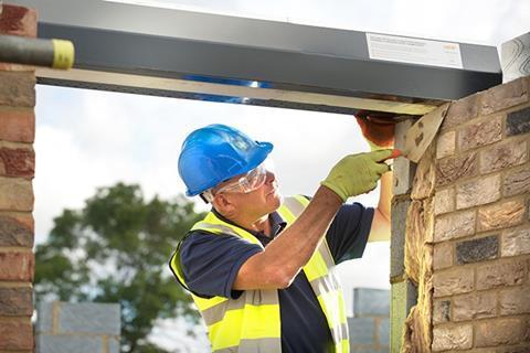 Installation of a steel lintel across a cavity wall